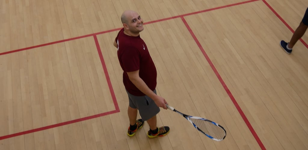 Roland Gallard the coach on the squash court